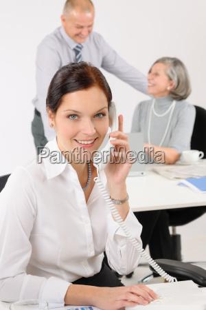 attractive businesswoman calling phone