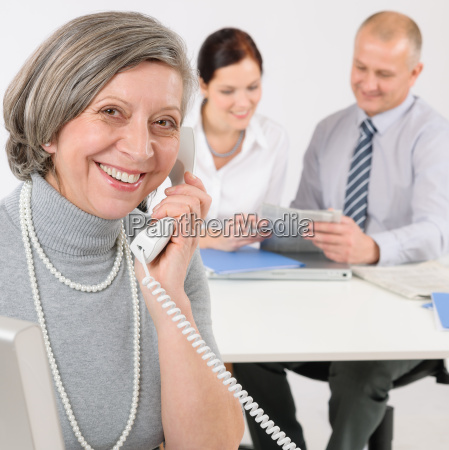 senior business woman on the phone