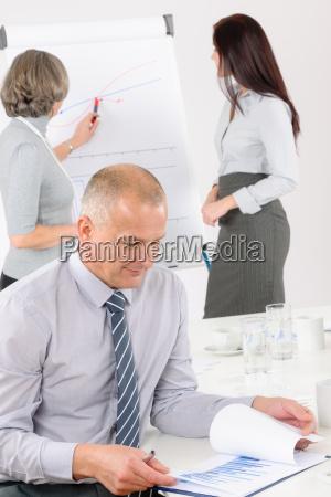 giving presentation mature man during meeting