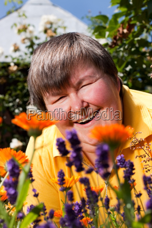 disabled woman lying on grass and