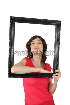 young woman posing inside a picture