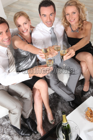 two young couples with champagne flutes