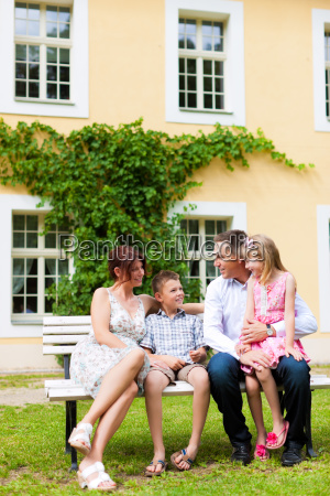 family sitting in front of their