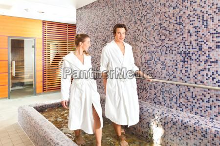 man and woman at wellness water
