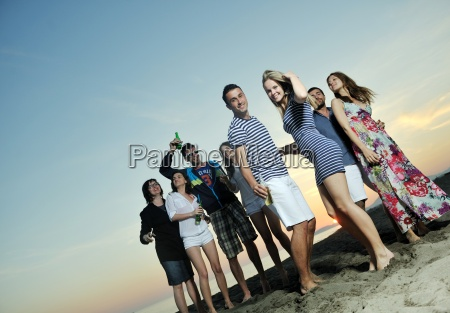 group of young people enjoy summer