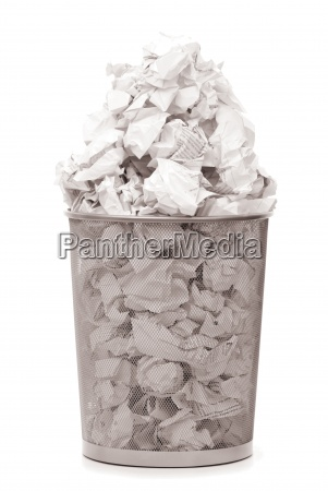 garbage bin with paper waste isolated