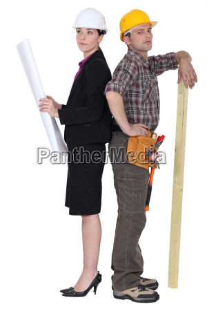 young female architect and carpenter standing