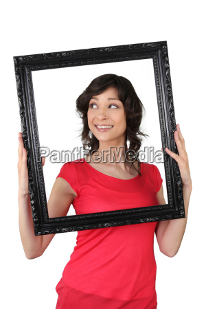a woman holding a wooden frame