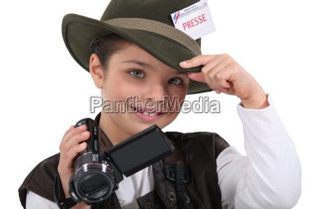little boy dressed as reporter