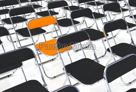 a folding chair into the crowd