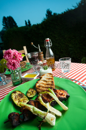 grilled chicken on a green outdoor