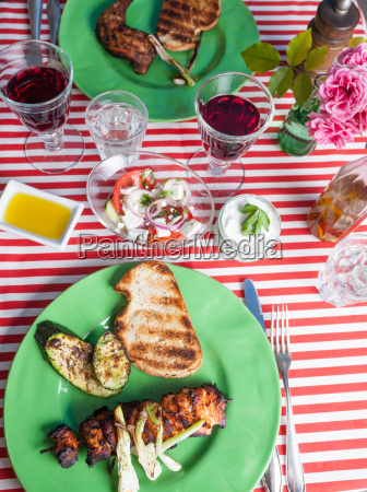 grilled chicken meat on a green