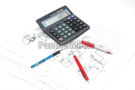 pens and calculator over the engineering
