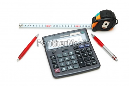calculator measuring tape and pens isolated