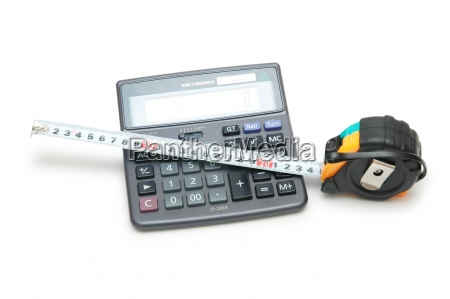 calculator and tape measure isolated on