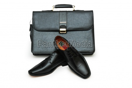 black briefcase and male shoes isolated
