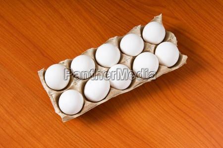 many white eggs on the wooden