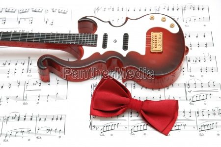 guitar and bow tie over the