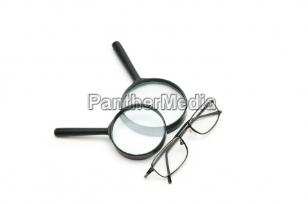 magnifying glasses and reading glasses isolated