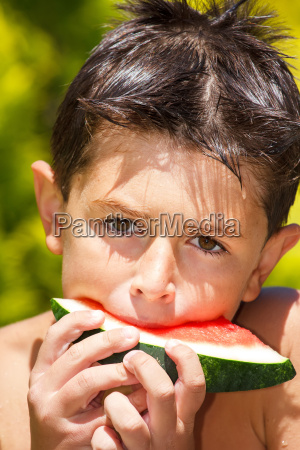 wet boy with watermelon in the
