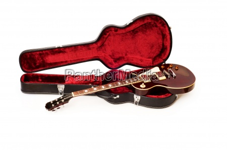 guitar in open case isolated on