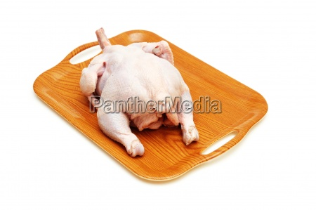 raw chicken in the wooden tray