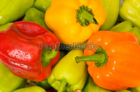 bell peppers arranged at the market
