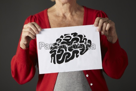 senior woman holding ink drawing of