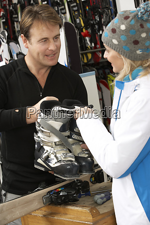 sales assistant helping advising female customer