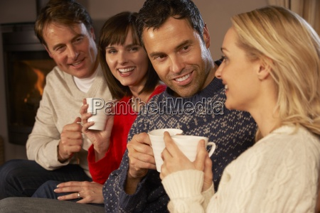 group of middle aged couples sitting