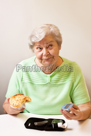 senior woman with diabetes keeps candy