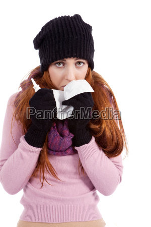woman with handkerchief and nasal spray