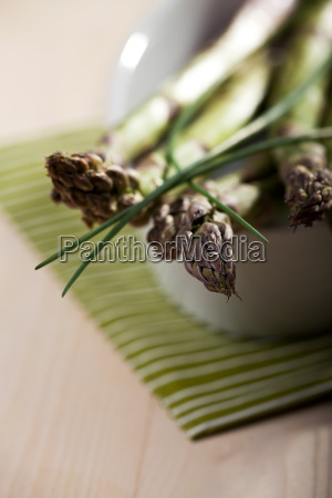 raw green asparagus and chives