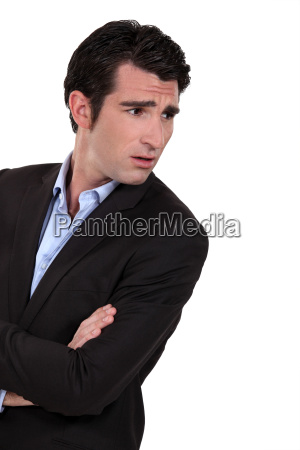 businessman with his arms folded in