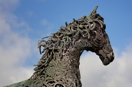 horse made of metal with horseshoe
