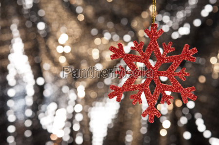 red snow flake on a gold