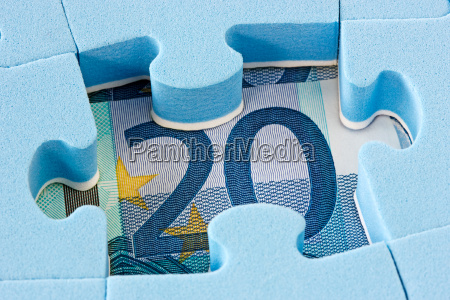 blue puzzle on euro currency