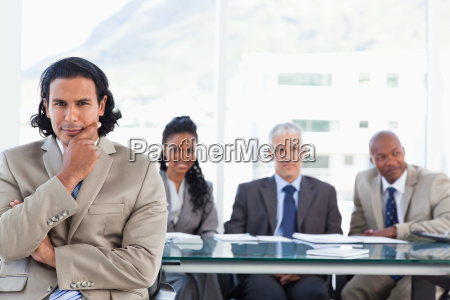 stern businessman with his hand on