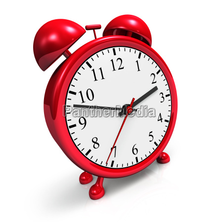 small red alarm clock against a