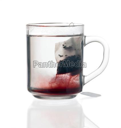 glass teacup with tea bag