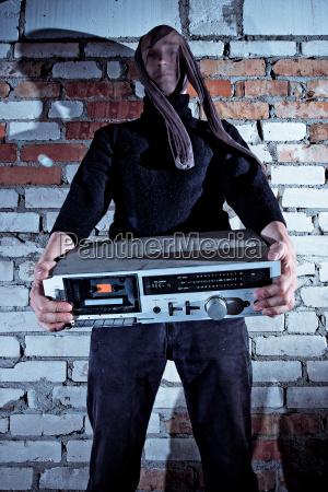 burglar stealing electronics