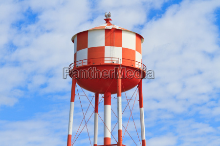 water tower with red and white