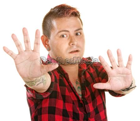 tense man reaching out