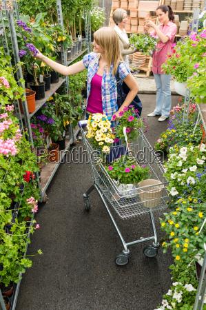 woman at garden centre shopping for