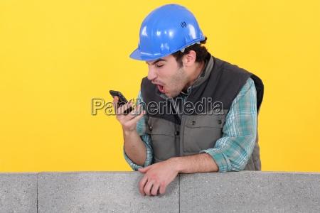 man staring at his mobile phone