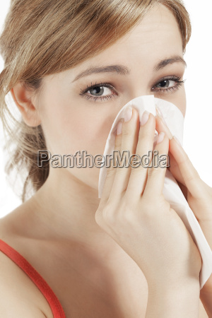young blond woman with hay fever