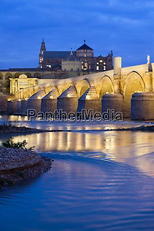 roman bridge on guadalquivir river at