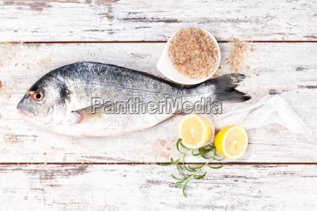 sea bream on white wooden background