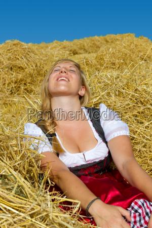 enjoying the sun in the straw