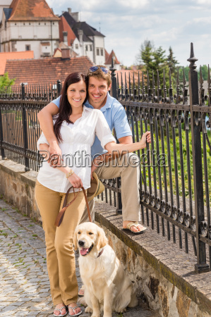 young couple with dog at historical